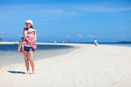 Young mother and her little daughter on tropical white sand beach Stock Photo - 7036927