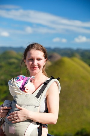 natural landmark: Young mother and her baby near Bohol Chocolate Hills natural landmark in Philippines