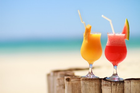 drinking straw: Two tropical fresh juices on tropical beach