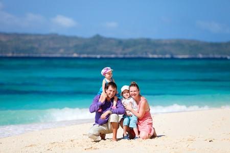 Family of four having fun on tropical beach Stock Photo - 7036921