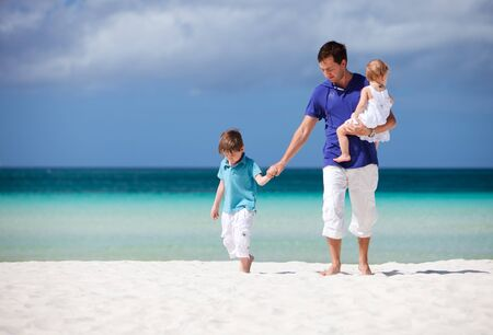 Happy father with his two kids on tropical beach vacation Stock Photo - 7089549