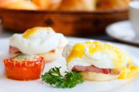 Delicious breakfast. Eggs benedict with ham on toast Stock Photo - 7314385