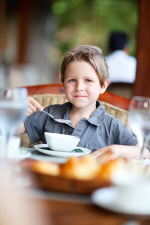 kids eating healthy: Cute boy having delicious breakfast