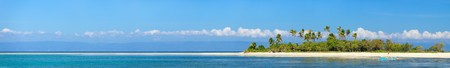 Panoramic photo of perfect tropical island in ocean