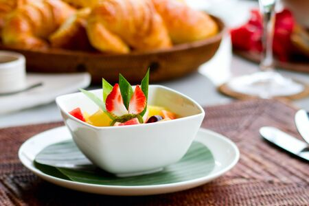 continental: Delicious breakfast with fresh fruits, fresh bread selection and coffee Stock Photo