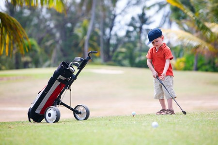 4 years old boy playing golf photo