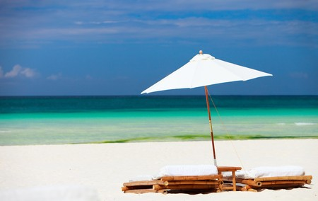 outdoor chair: Beach chairs on perfect tropical white sand beach Stock Photo