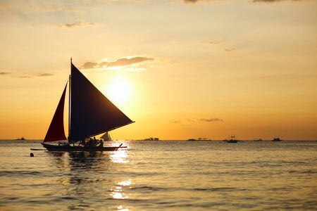 Sailboats against beautiful sunset in Boracay Philippines photo