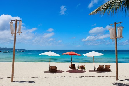 boracay: Beach chairs on perfect tropical white sand beach Stock Photo