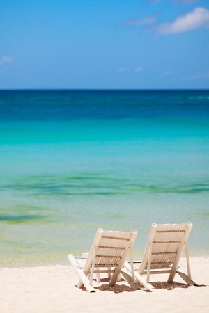 paradise bay: Beach chairs on perfect tropical white sand beach Stock Photo