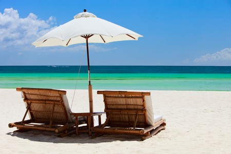 Beach chairs on perfect tropical white sand beach Stock Photo - 7543981
