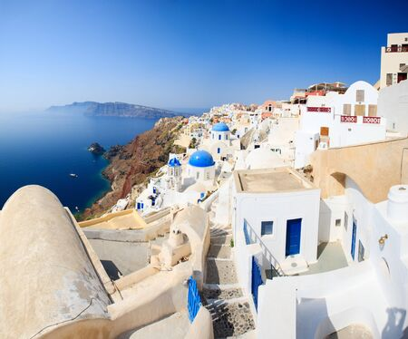 santorini: Traditional white and blue Oia village in Santorini Stock Photo