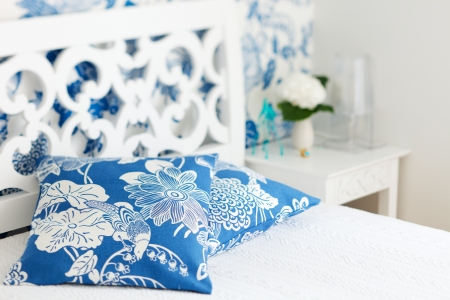 Pillows closeup in nicely decorated bedroom in blue and white colors Stock Photo - 7598292