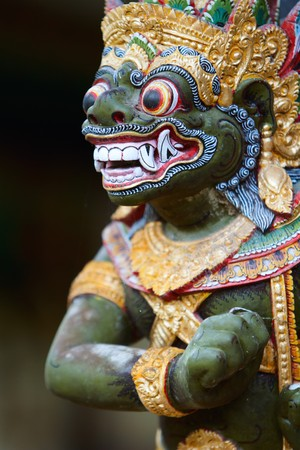 god figure: Closeup of traditional Balinese God statue in Central Bali temple