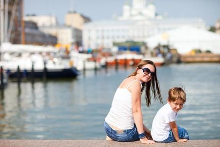 Финляндия: Mother and son enjoying views of city center Helsinki Finland