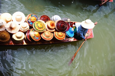 Vendor on Damnoen Saduak Floating Market near Bangkok in Thailand photo