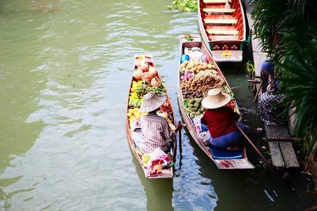 Two vendors on Damnoen Saduak Floating Market near Bangkok in Thailand photo