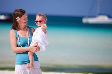Mother and her adorable toddler daughter portrait at beach Stock Photo - 7819584