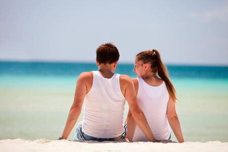 Rear view of romantic couple at tropical beach photo