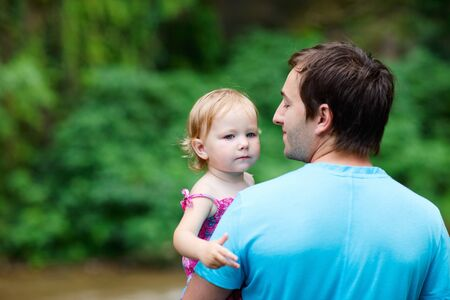 Rear view of father and his little daughter outdoors Stock Photo - 7819471