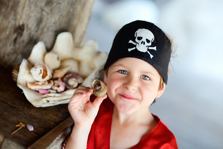 Portrait of playful boy dressed as pirate photo