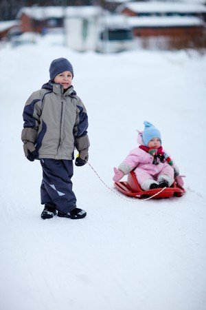 Two small kids outdoors on winter day photo