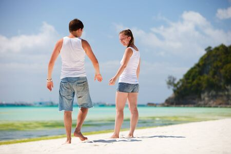 Lifestyle photo of romantic couple at tropical beach photo