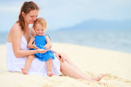 Young mother and her little toddler daughter on tropical vacation photo
