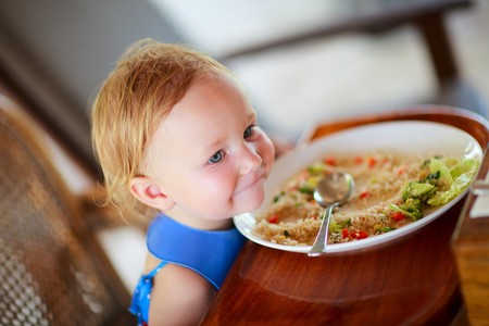 mealtime: Adorable toddler girl eating healthy lunch