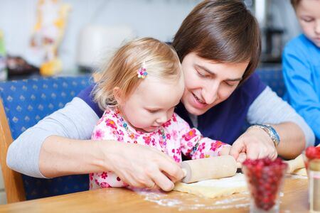 Portrait of father and his little daughter in kitchen baking together Stock Photo - 7941711