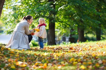 Mother and her little daughter at beautiful autumn park Stock Photo - 7941706