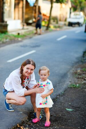Casual portrait of mother and daughter traveling together in Asian country photo