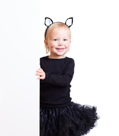 Cute little toddler girl with banner dressed for Halloween as black cat photo