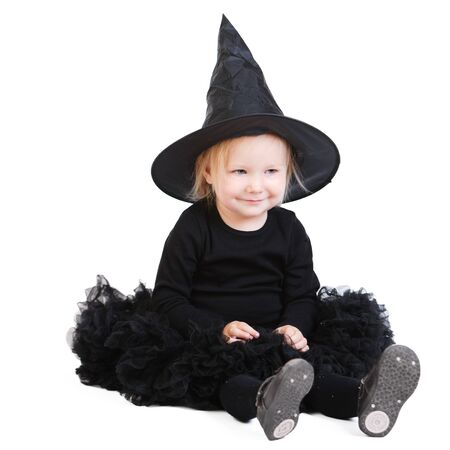 Halloween little witch isolated on white background photo