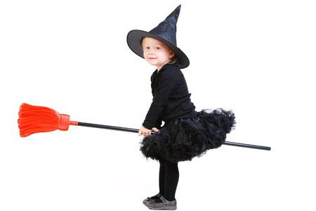 flying witch: Adorable little witch flying on broomstick isolated on white
