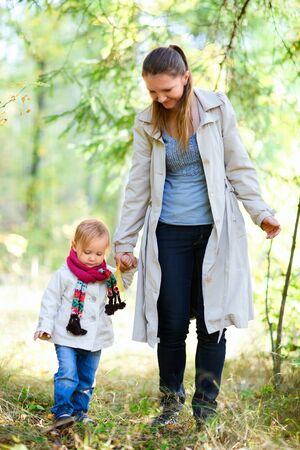 Mother and her little daughter at autumn forest Stock Photo - 8061037