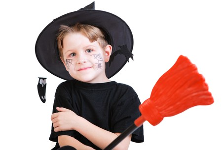 Halloween studio portrait of cute boy with broomstick isolated on white photo
