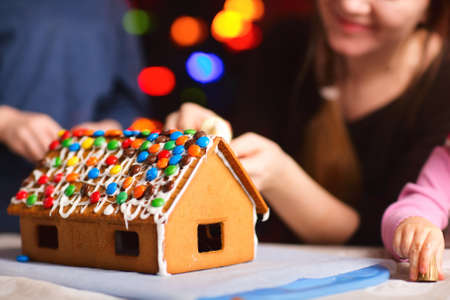 Closeup of gingerbread house decorated with colorful candies photo