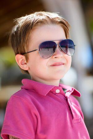 fashionable sunglasses: Portrait of cute 5 years old boy wearing sunglasses Stock Photo