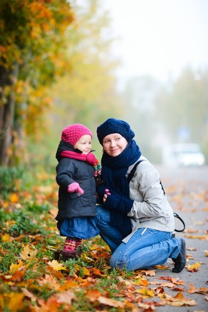 Mother and daughter outdoors on beautiful foggy day photo