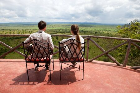 tanzania: Couple on balcony of safari lodge