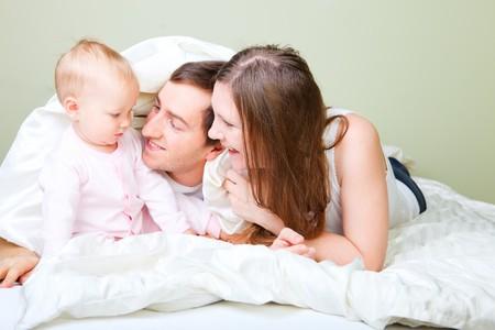 Family in bedroom Stock Photo - 8158754