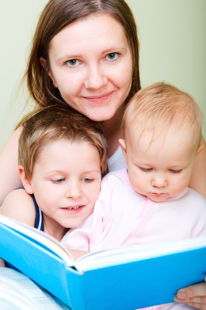 Family reading in bed Stock Photo - 8158755