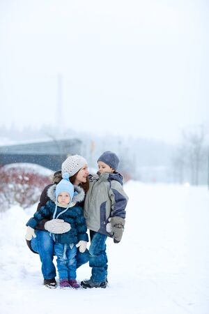 Young mother with two kids outdoors on beautiful winter day Stock Photo - 8296848