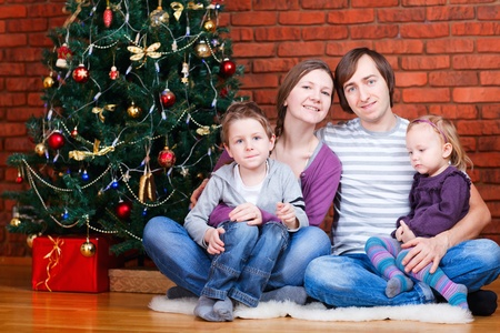 Family of four at home celebrating Christmas Stock Photo - 8296852