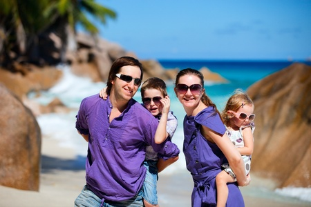Portrait of happy young family with two kids on tropical vacation Stock Photo - 8592829