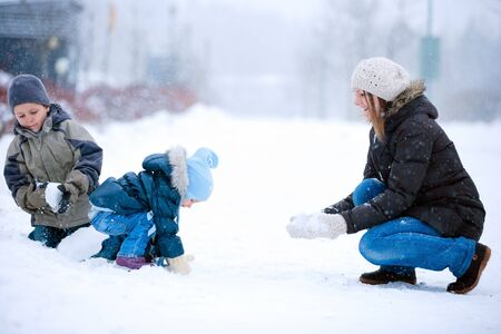 Mother and two kids having fun outdoors on beautiful winter day Stock Photo - 8610866