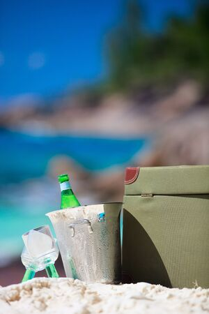 Closeup of beach picnic on exotic white sand beach photo