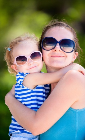 Portrait of happy mother and her adorable little daughter photo