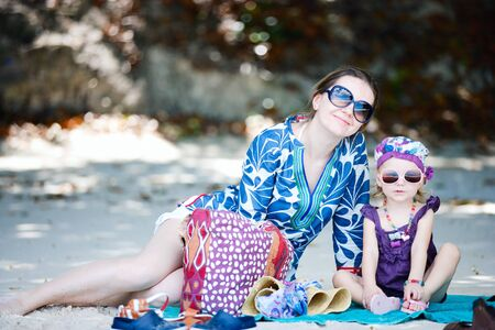 Happy mother and her adorable little daughter on beach Stock Photo - 8645615